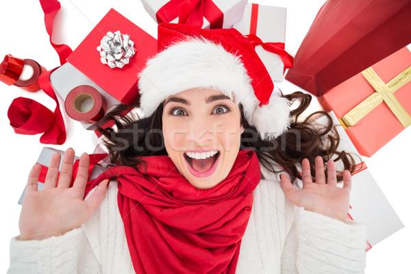 Excited brunette lying near christmas presents  Stock photo © wavebreak_media