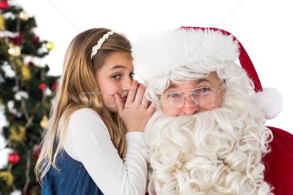 Little girl teling santa claus a secret Stock photo © wavebreak_media