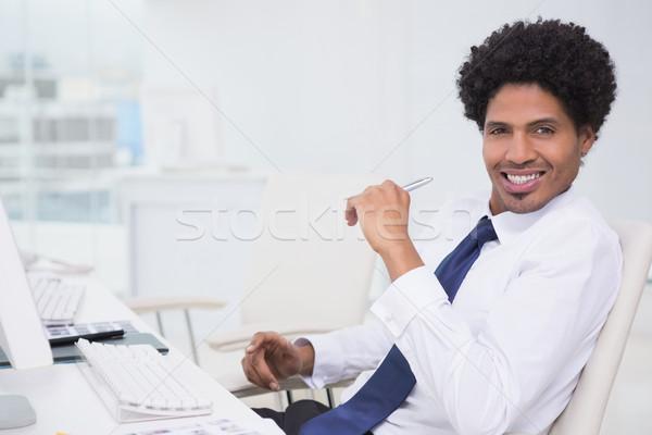 Handsome photo editor working at desk Stock photo © wavebreak_media