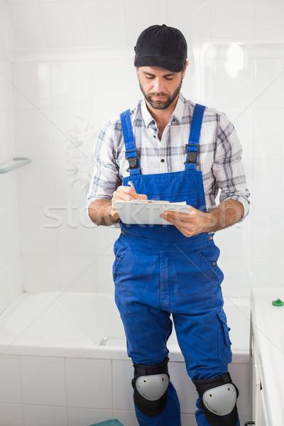 Plumber taking notes on clipboard Stock photo © wavebreak_media