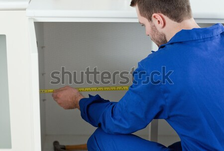 Man puting silver duct tape on the corners of the wall Stock photo © wavebreak_media