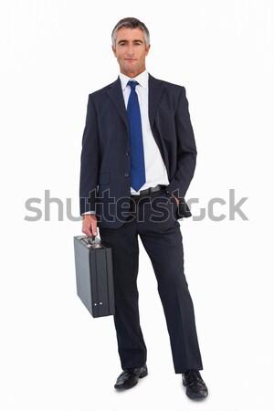 Smiling businessman holding black briefcase  Stock photo © wavebreak_media