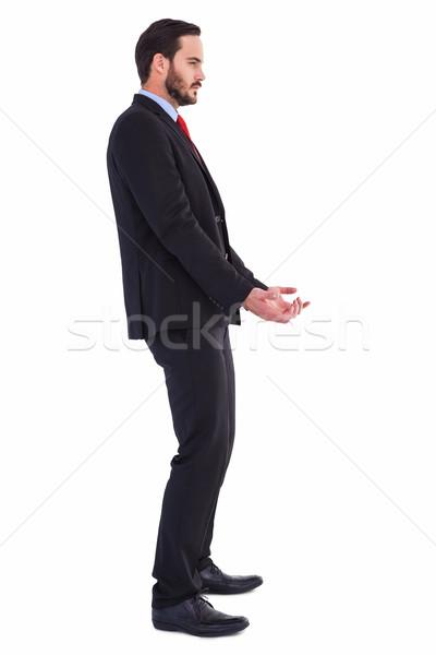 Unsmiling businessman holding something with his hands Stock photo © wavebreak_media