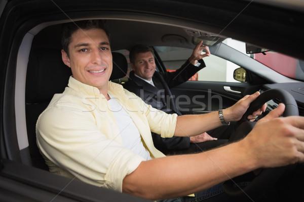 Empresário indicação carro interior sala de exposição Foto stock © wavebreak_media
