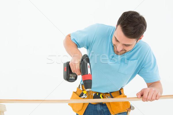 Stockfoto: Bouwvakker · hand · boor · houten · plank · mannelijke