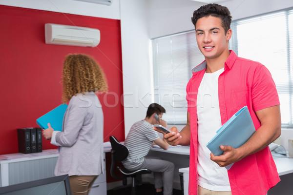 улыбаясь студент смартфон Одноклассники колледжей женщину Сток-фото © wavebreak_media