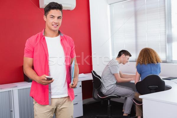Estudiante cuaderno teléfono universidad Foto stock © wavebreak_media