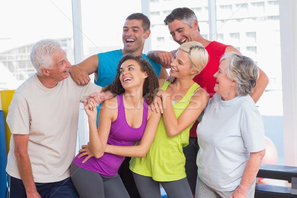 Playful friends looking at man at fitness studio Stock photo © wavebreak_media