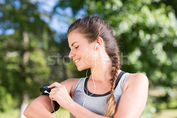 Fit brunette on a run in the park Stock photo © wavebreak_media