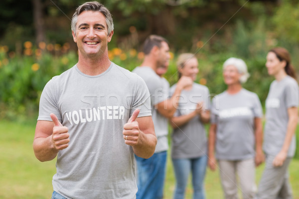 Happy volunteer with thumb up  Stock photo © wavebreak_media