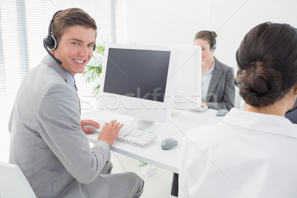 Smiling businessman wearing headset  Stock photo © wavebreak_media