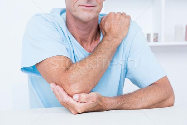Homem sofrimento cotovelo dor médico escritório Foto stock © wavebreak_media