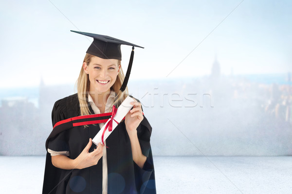 Stock photo: Composite image of woman smiling at her graduation