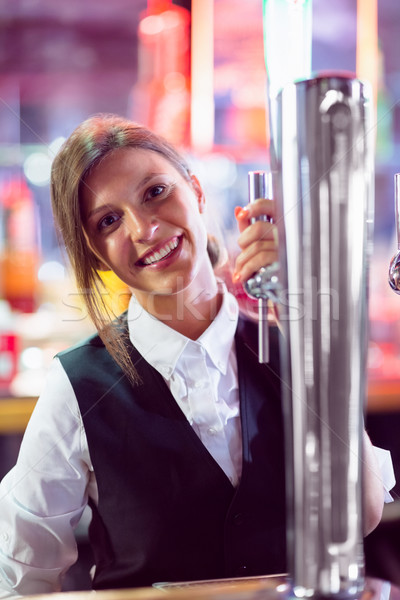 Pretty barmaid pulling pint of beer Stock photo © wavebreak_media