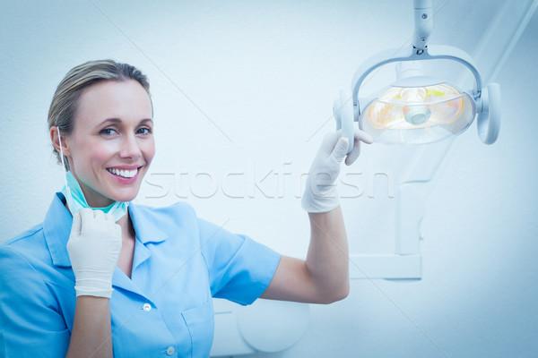 улыбаясь женщины стоматолога свет портрет женщину Сток-фото © wavebreak_media