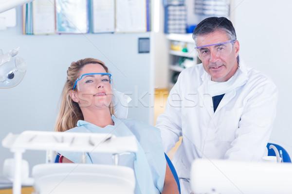 пациент стоматолога улыбаясь камеры стоматологических клинике Сток-фото © wavebreak_media