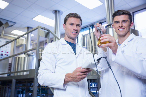 Men testing product and smiling at the camera Stock photo © wavebreak_media