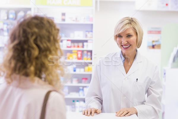 Stock photo: Pharmacist smiling at costumer