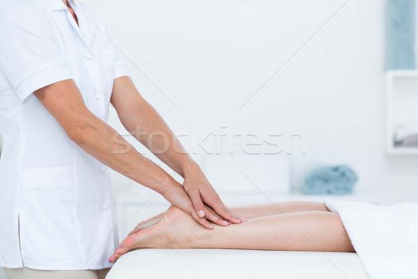 Physiotherapist doing foot massage Stock photo © wavebreak_media
