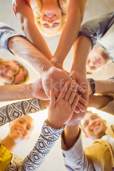 Happy business team joining their hands Stock photo © wavebreak_media