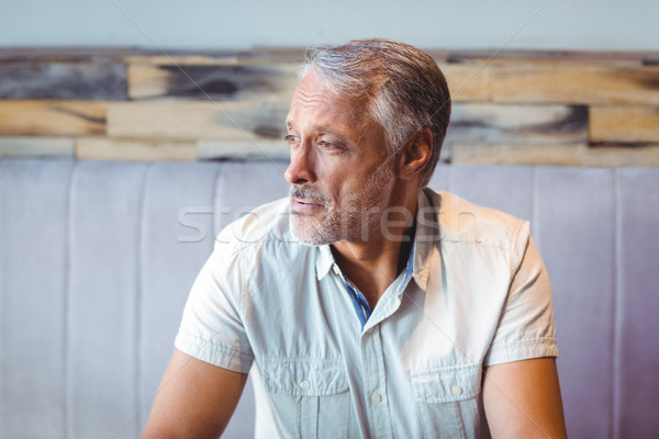 Thoughtful man looking away in coffee shop Stock photo © wavebreak_media