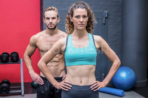 Muskuläre Paar schauen Kamera Frau vor Stock foto © wavebreak_media