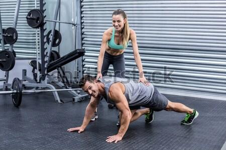 Muskularny człowiek sztanga crossfit siłowni Zdjęcia stock © wavebreak_media