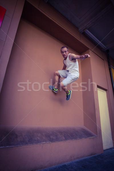 Man doing parkour in the city Stock photo © wavebreak_media