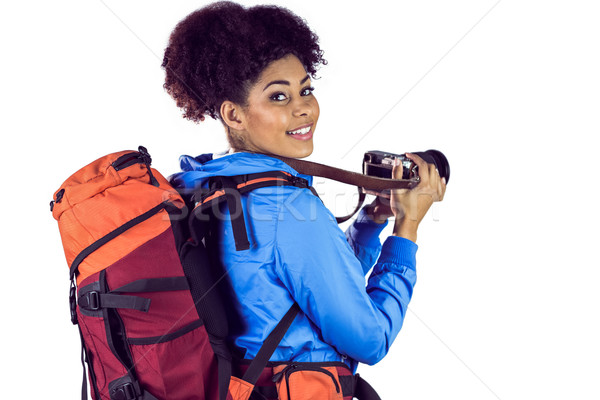 Portrait of a young woman with backpack taking picture Stock photo © wavebreak_media
