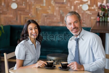 Portrait of business colleagues holding disposable coffee cup Stock photo © wavebreak_media