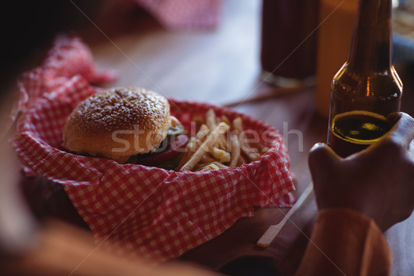 Persona birra fast food ristorante fast food alimentare hotel Foto d'archivio © wavebreak_media