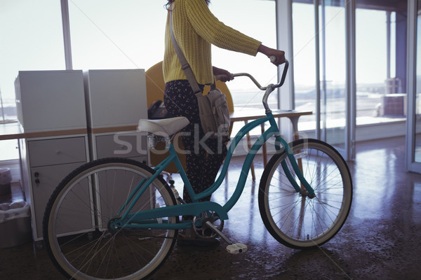 Businesswoman with bicycle creative office Stock photo © wavebreak_media