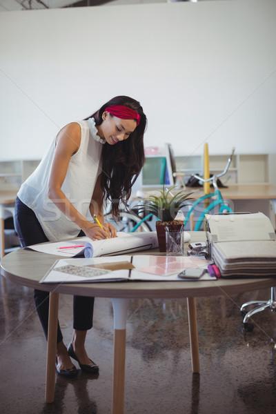 Young entrepreneur working at office desk Stock photo © wavebreak_media