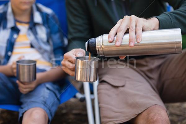 Syn ojciec pić kubek Zdjęcia stock © wavebreak_media