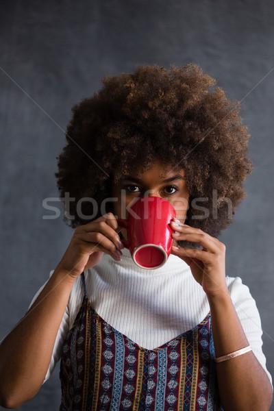 Portrait of woman with frizzy hair drinking coffee Stock photo © wavebreak_media
