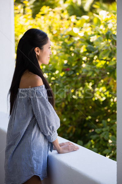 Thoughtful young woman leaning on retaining wall in cafe Stock photo © wavebreak_media
