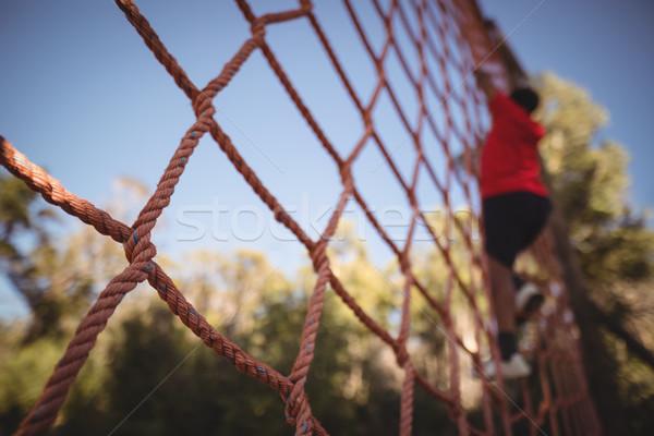 Jongen klimmen net kamp kind Stockfoto © wavebreak_media