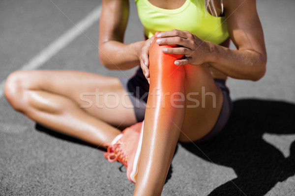 Low section of sportswoman suffering from joint pain Stock photo © wavebreak_media