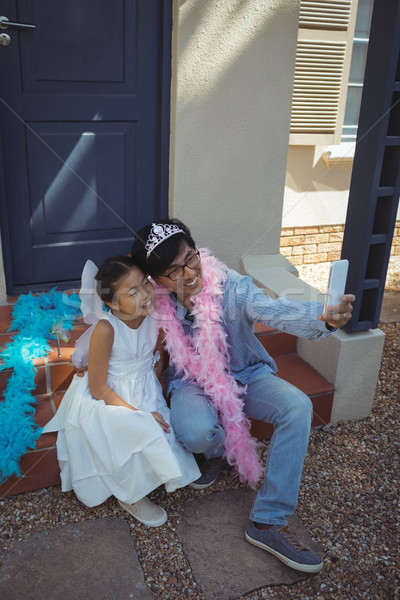 Father and daughter in fairy costume taking a selfie Stock photo © wavebreak_media