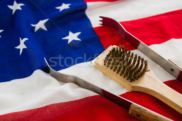 Tong and brush on American flag Stock photo © wavebreak_media