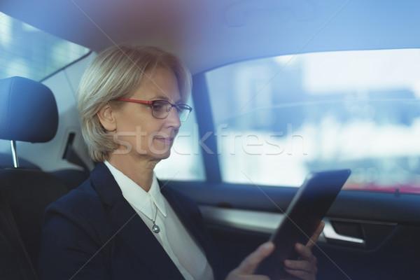 Businesswoman using tablet computer Stock photo © wavebreak_media