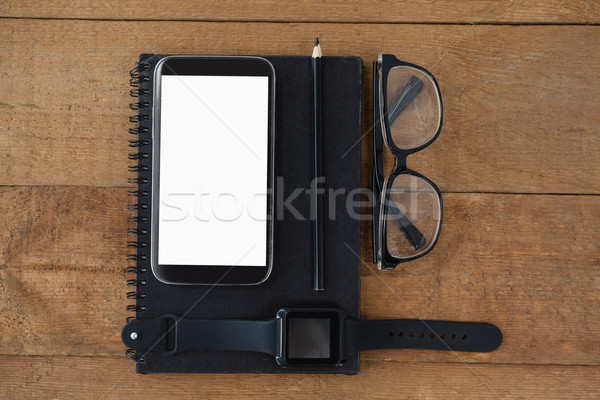 diary, smart watch, pencil, smartphone and spectacles  Stock photo © wavebreak_media