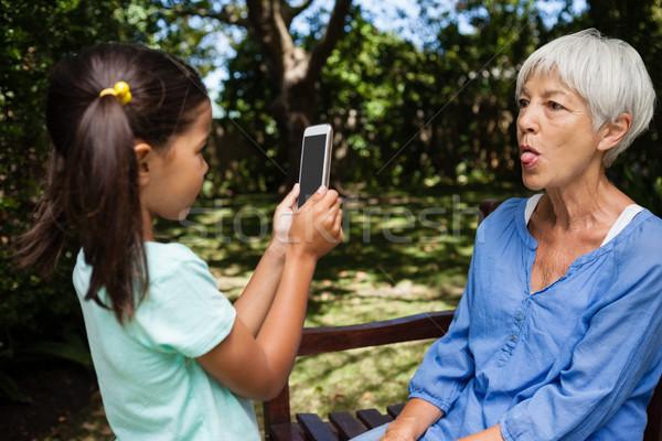 Lány elvesz fénykép nagymama ki nyelv Stock fotó © wavebreak_media