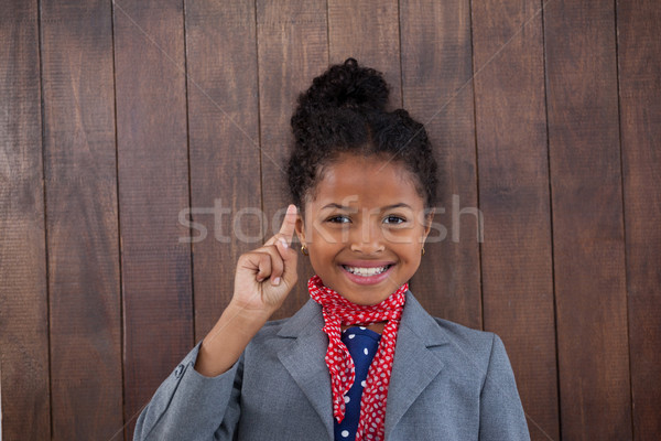 Portrait of smiling businesswoman pointing upwards Stock photo © wavebreak_media