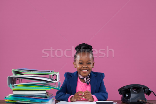 Portrait of smiling businesswoman with files and telephone at desk  Stock photo © wavebreak_media