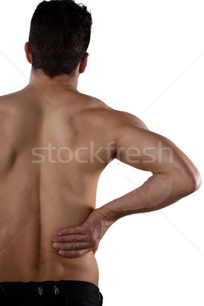 Rear view of shirtless player suffering from pain Stock photo © wavebreak_media