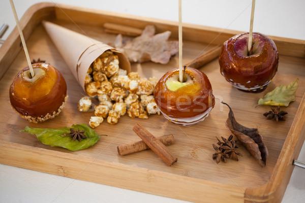 Popcorn, apple and apise on wooden tray Stock photo © wavebreak_media