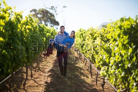 Rear view of female vintner walking in vineyard Stock photo © wavebreak_media
