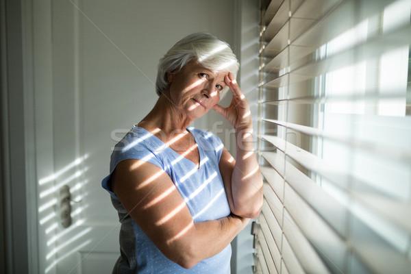 Gergin kıdemli kadın ayakta pencere yatak odası Stok fotoğraf © wavebreak_media