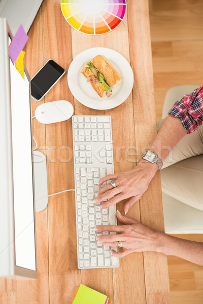 Casual designer working with computer Stock photo © wavebreak_media